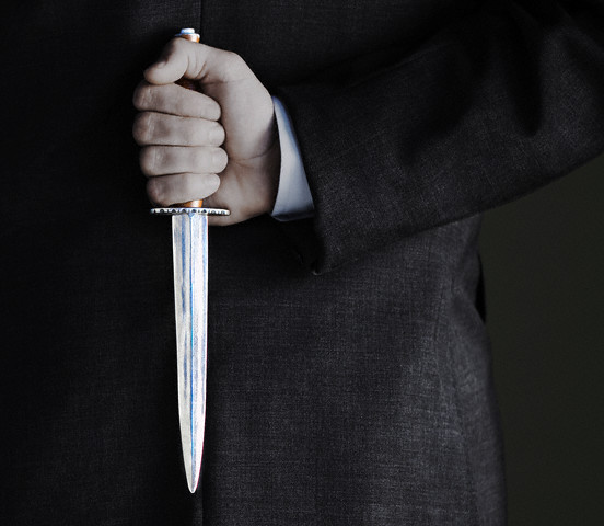 Man Holding Knife --- Image by © moodboard/Corbis